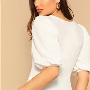 White fitted blouse with puff sleeves